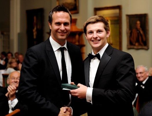 Top of the form: Reading School's Stuart Parsons, the inaugural winner of the Walter Lawrence Trophy award for the highest schools scorer against MCC – an impressive 212 not out –  receives a special medallion and £250 from former England skipper Michael Vaughan.