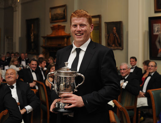 When Irish eyes are smiling: Gloucestershire's Kevin O'Brien with the 2011 Walter Lawrence Trophy, won for his 44-ball hundred, at the presentation dinner in The Long Room at Lord's.