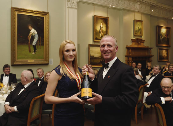 Gilding the Lilly! Winner of the Walter Lawrence Women's Award, Essex's Lilly Reynolds, receives her special silver medallion, cheque for £500 and a magnum of Veuve Clicquot from the evening's host Matthew Fleming.