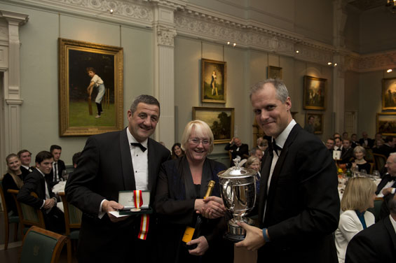 Proud parents: Guest speaker, Ed Smith, presents the Walter Lawrence Trophy, plus a cheque for £3,000, special medallion and a magnum of Veuve Clicquot to Tom Kohler-Cadmore's  mother and father.