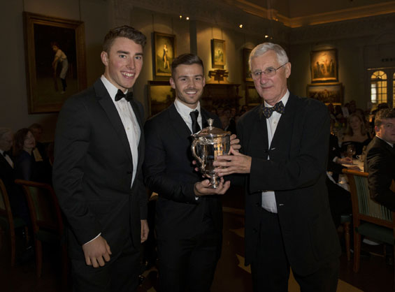 Helping hands: Joe Weatherley and Lewis McManus, Hampshire team mates of Shahid Afridi accept the Walter Lawrence Trophy and a cheque for £3000 on his behalf from Mike Brearley.