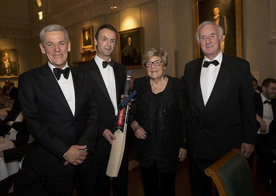 Runs in the family: Father Ted and grandparents Irene and Brian Lewis, step in to receive a special medallion and Gray-Nicolls cricket bat on behalf ot the absent Walter Lawrence Schools Award winner, Will Buttleman.