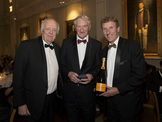Sciver's spoils: Sir Tim Rice presents a special medallion, a cheque for £500 and a bottle of Veuve Clicquot to grandfather, John, and father, Richard, on Natalie's behalf.
