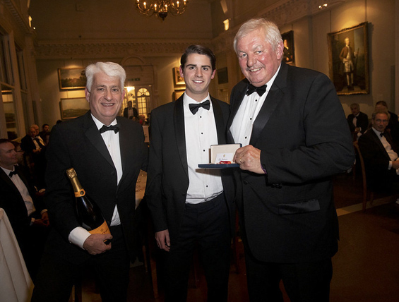 Batchelor Party: (left to right) Father, Tim, and brother, Tom, receive the MCC Universities Award on behalf of winner Olly Batchelor from former Chairman of the England Test Selectors, David Graveney.