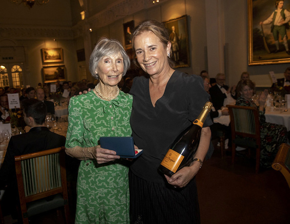 Ladies on Knight duty: Verity Thornton (left), wife of the WLT President, Brian, accepts the Walter Lawrence Women's Award on behalf of the absent winner, Heather Knight, from Marian Wreford, the wife of recent MCC President, Anthony.
